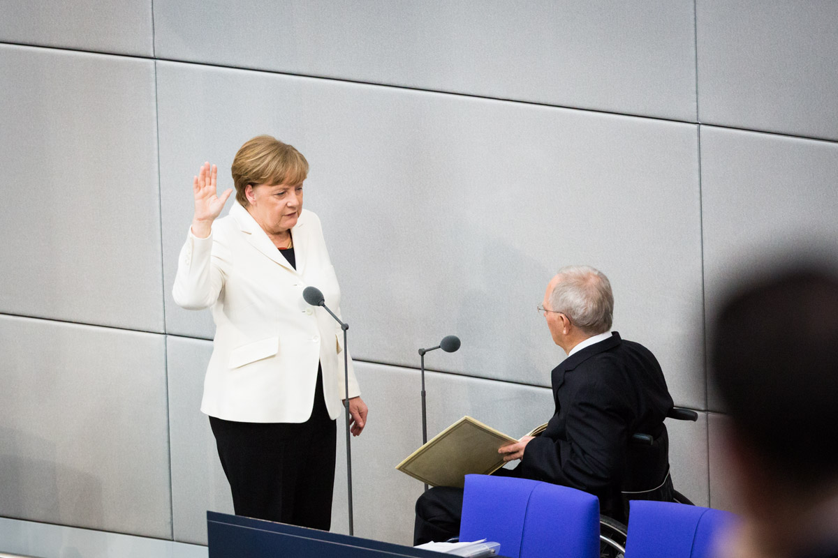 Chancellor Angela Merkel is sworn in by the President of the Bundestag, Wolfgang Schäuble, in the German Bundestag
